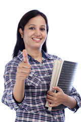 Indian female student with thumbs up