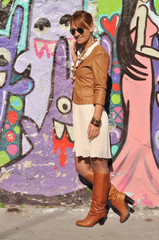 Women with casual style leaned on the wall