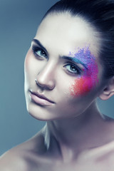 woman with coloured powder above eye