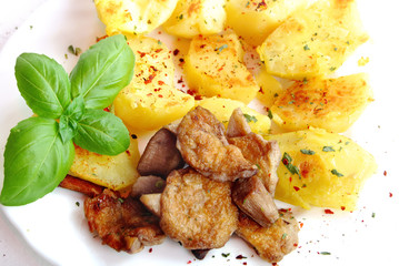 dish of fried potatoes with mushroom and basil