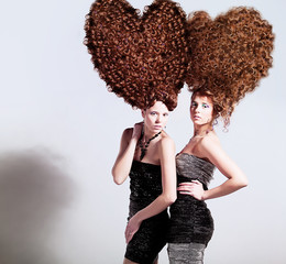 two sexy girls with big heart-shaped hairstyle