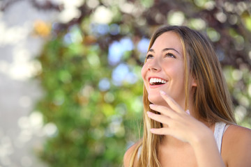 Beautiful woman laughing and looking above
