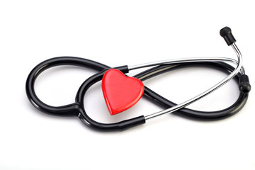 Stethoscope and red heart isolated on white