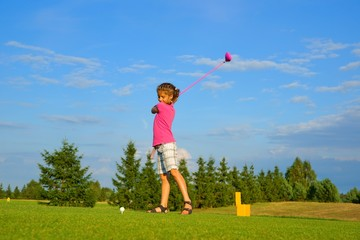 Golf, girl golfer is going to punch the ball