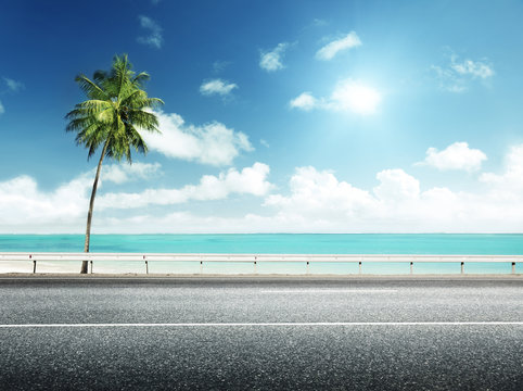 asphalt road and sea