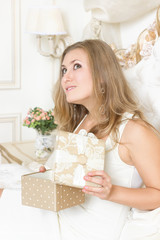 girl gifts relaxing on bed at home luxury interior