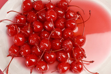 Red cocktail maraschino cherries with stems