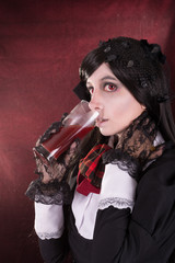 Portrait of a woman in retro costume, with wine