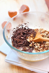 Chopped chocolate and walnuts in glass bowl