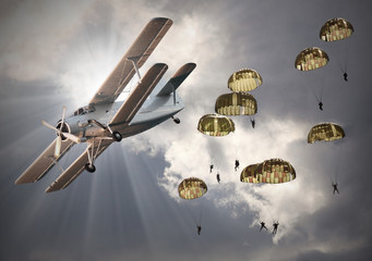 Retro style picture of the biplanes with sky divers.