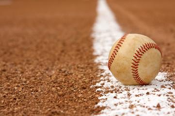 Worn Baseball on the Chalk Line