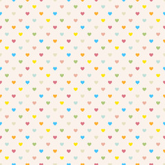 Seamless polka dot colorful pattern with hearts.