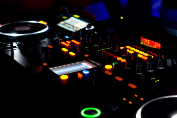 Turntables and music mixing deck at a disco
