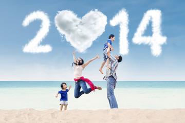 Cheerful family celebrate new year at beach