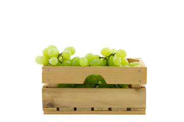 wooden crate filled with white grapes isolated on white