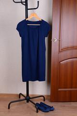 Dress hanging on hanger near door