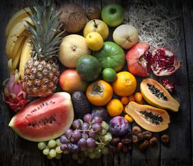 Exotic fruits variety still life on vintage wooden boards