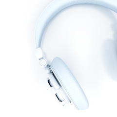 white headphones with leather ear pads on white background
