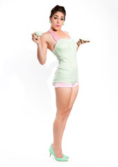 Sexy fifties pin-up girl with pink lipstick wearing a green and