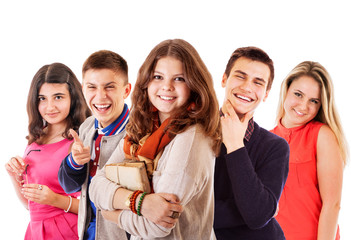Group of cheerful teenagers on the white background