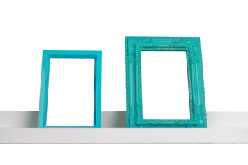 picture frames on the shelf