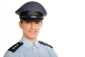 Portrait of young smiling policeman on white background.