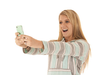 blonde woman talking cell phone picture of herself