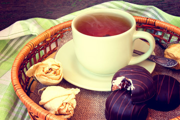 cup of tea and tasty chocolate cakes
