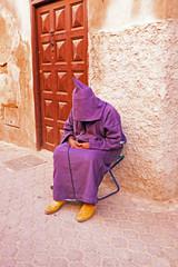 Sleeping maroccan man in the streets of Marrakech