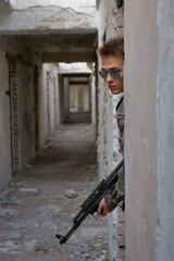 Teenager, boy in battle dress and a rifle, Air Soft Gun