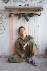 Teenager, boy in battle dress, of knife and rifle, Air Soft Gun