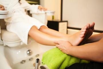 Feet massage during spa treatmen.