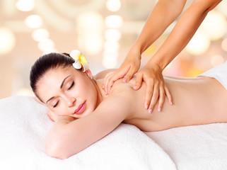 Wall Mural - Woman having massage of body in spa salon