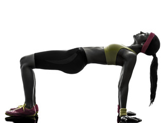 woman exercising plank position fitness workout silhouette