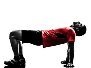 Wall Mural - man exercising plank position fitness workout silhouette