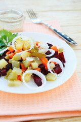 salad with beetroot on a white plate