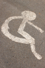 patient wheelchair sign on asphalt road