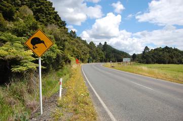 Yellow kiwi bird road sign at roadside