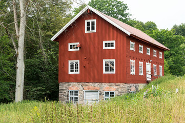 Old water powered red wooden mill
