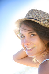 Portrait of beautiful woman with hat, light effect