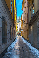 Picturesque narrow street in Old Town in Stockholm, Sweden.