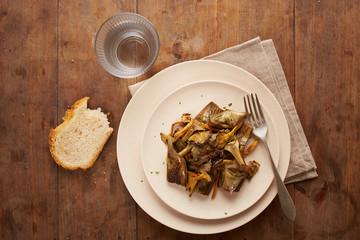 Dish of sauteed artichokes and yellow foot mushrooms