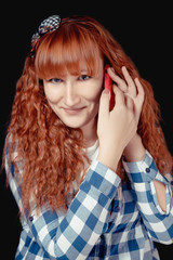 Red hair girl talking on the phone