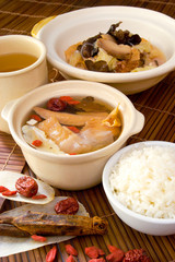 Chicken and herb soup in pot, Chinese food style