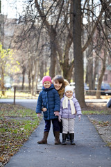 Mother and her little girls outdoors session
