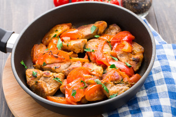 Fried pork with pan-roasted tomatoes