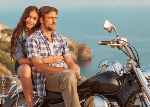 Fototapete fashion couple sitting on a motorcycle