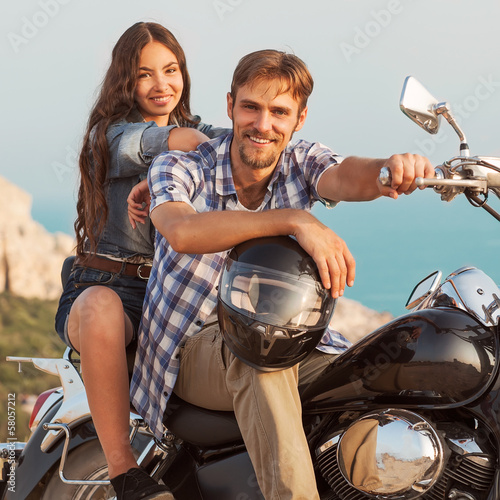 Wall mural fashion couple sitting on a motorcycle