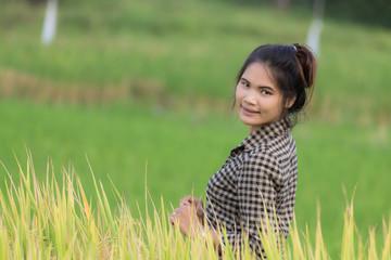 Woman farmer in Green Cornfield