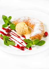 strudel with ice cream decorated with mint leaves
